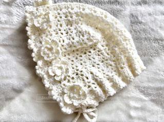 赤ちゃんのために編んだかぎ編みの帽子♪の写真・画像素材[1085564]