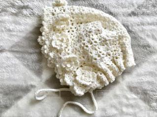 赤ちゃんのために編んだ帽子♪の写真・画像素材[1085565]