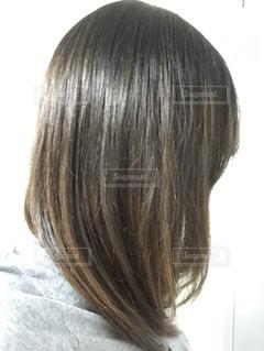 ストレートロングヘアの女性の髪の写真・画像素材[1205145]