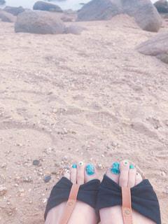 砂浜とサンダルの写真・画像素材[1260246]