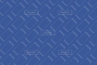 近くに青い壁のアップの写真・画像素材[1562424]