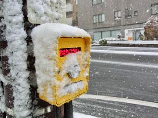 雪に覆われたパーキング メーターの写真・画像素材[971331]