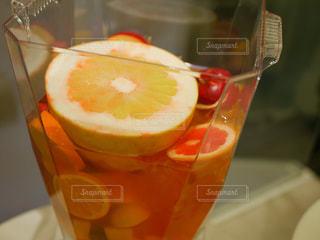 オレンジ ジュースのガラス - No.1009723