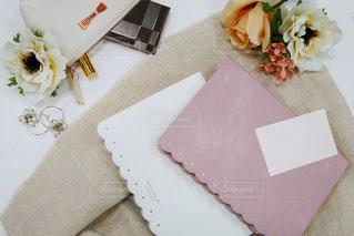 テーブルの上にある手帳の写真・画像素材[1416051]
