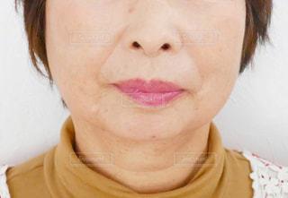 年配の女性の口元の写真・画像素材[1584899]