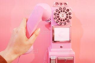 電話機を持っている手の写真・画像素材[1654148]