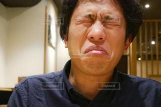 酸っぱい顔の男性の写真・画像素材[2276220]