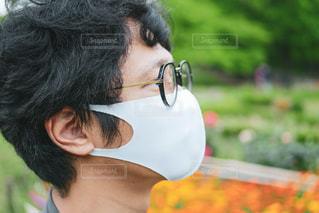 眼鏡をかけている男のクローズアップの写真・画像素材[3209576]