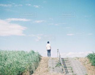 河川敷とカメラ男子の写真・画像素材[1452802]