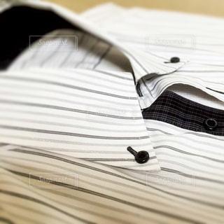 ワイシャツのボタンの写真・画像素材[309316]