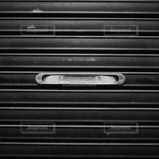 商店街のシャッターについてる手紙や新聞の投函口の写真・画像素材[1615339]