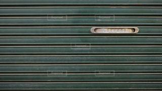 商店街のシャッターについてる手紙や新聞の投函口の写真・画像素材[1615343]