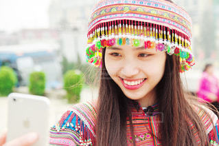 近くに帽子をかぶっている女の子のの写真・画像素材[1184034]