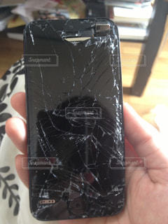 息子の悲惨な携帯電話の写真・画像素材[849609]