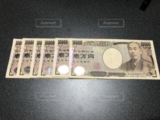 複数の一万円札の写真・画像素材[4916046]