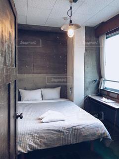 ゲストハウスのベッドルームの写真・画像素材[961561]