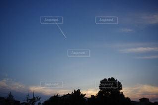 飛行機雲。の写真・画像素材[741873]