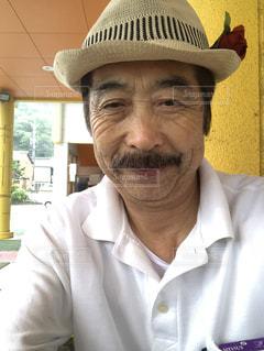 帽子をかぶった男の写真・画像素材[1448107]