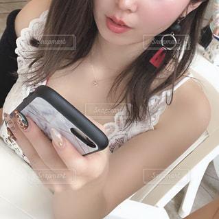 携帯電話で通話中の女性の写真・画像素材[1761307]