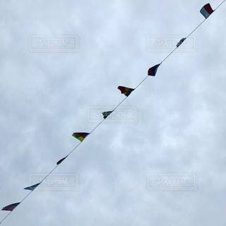 くもりと国旗の写真・画像素材[1530225]