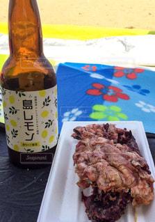 タコとビールの写真・画像素材[1375944]