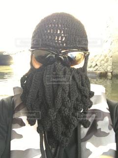 帽子をかぶった人 フルフェイスマスクの写真・画像素材[2875958]