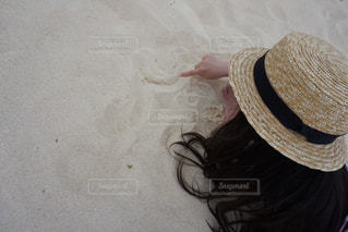 帽子をかぶっている人の写真・画像素材[1139337]