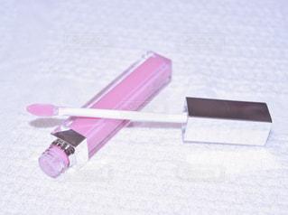 ピンクのリップグロスの写真・画像素材[853657]