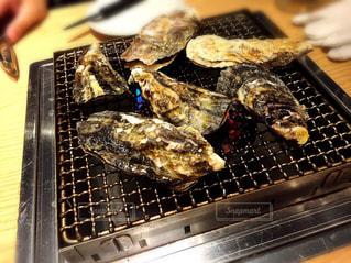 グリルで牡蠣を調理人の写真・画像素材[848441]