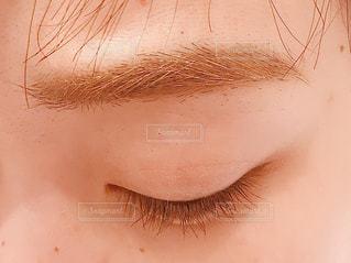 眉とまつげの写真・画像素材[1728513]
