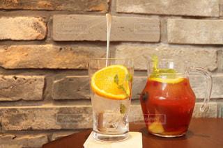 オレンジ ジュースのガラスの写真・画像素材[1142908]