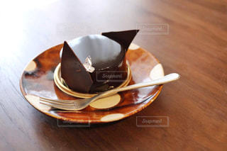 木製のテーブルの上に座ってコーヒー カップの写真・画像素材[1447908]