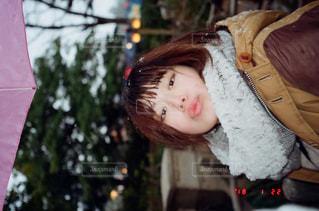 雪の日のディズニーデートの写真・画像素材[989301]