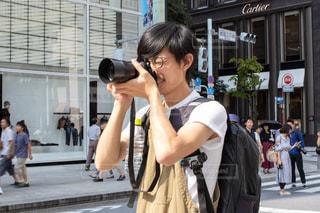 街の写真を撮る人の写真・画像素材[2442722]