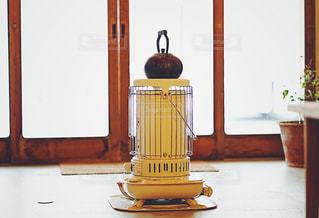 ストーブの上でお湯を温めるの写真・画像素材[1729799]