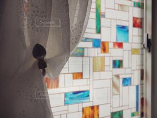 お洒落な窓とカーテンの写真・画像素材[1166585]