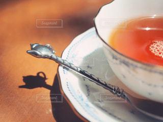 可愛いティースプーンと紅茶の写真・画像素材[1178314]
