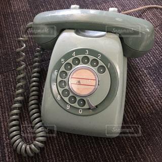 ダイヤル式電話の写真・画像素材[3211436]