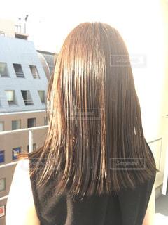 カメラを見て赤い髪の女の写真・画像素材[844300]