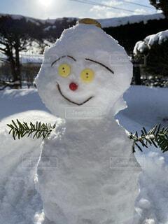 夫が作った雪だるまの写真・画像素材[4003228]