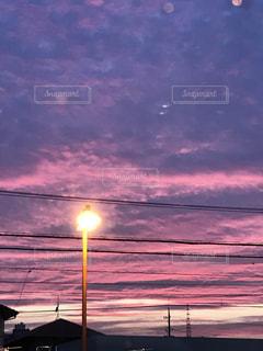 街に沈む夕日の写真・画像素材[1506131]
