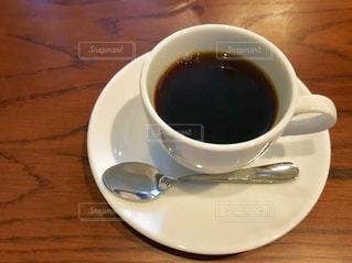 テーブルの上のコーヒー ☕の写真・画像素材[1555865]
