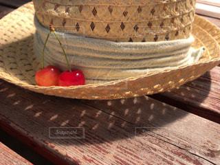 初夏と帽子とさくらんぼと。の写真・画像素材[1270430]