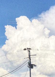 入道雲と電線たち。の写真・画像素材[1406931]