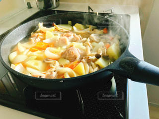 フライパンで料理中の写真・画像素材[1646741]