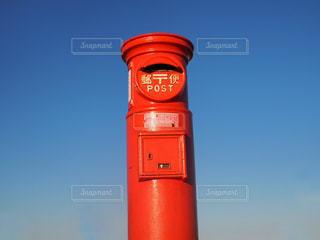 バック グラウンドで小さな時計塔の写真・画像素材[1522751]