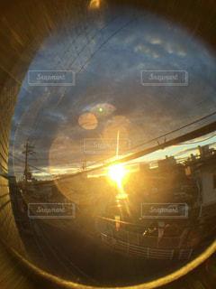 朝陽とレンズの写真・画像素材[712440]