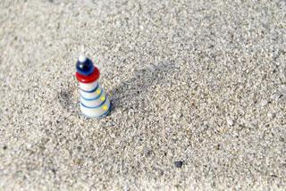 砂浜で撮影した灯台のガラス細工の写真・画像素材[1188919]