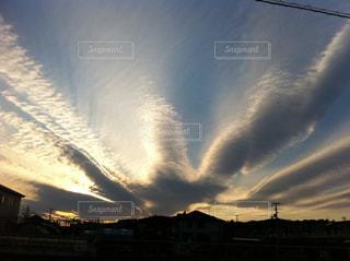 空と雲と夕陽の写真・画像素材[733962]