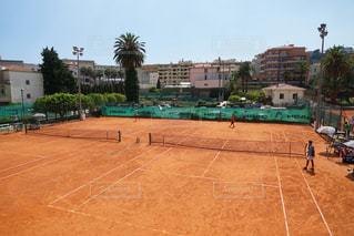 赤土のテニスコートの写真・画像素材[1381482]